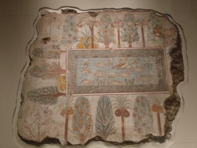 Egyptiläinen puutarha, seinämaalaus Nebamumsin haudasta Theba 1380 ekr. Koristelampi keskellä, pyhiä lootuksenkukkia ja mm taatelipalmuja